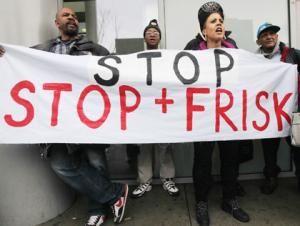 "protestors hold sign saying ""stop stop + frisk"""