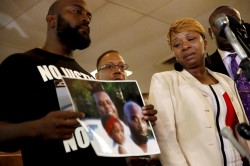parents of michael brown hold a photo of the slain teen