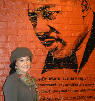 Rachel Dolezal standing before a mural of MLK