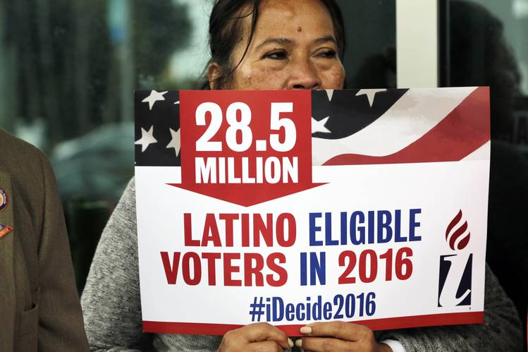 Woman Holds Latino Eligible Voter Sign