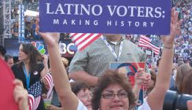 Woman Holds Latino Voters: Making History Sign Aloft